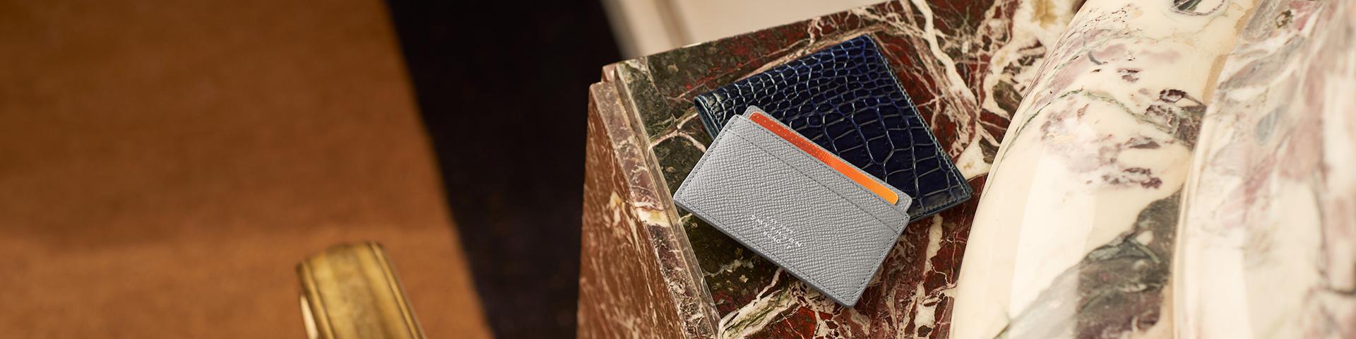 Brieftaschen und Kartenetuis